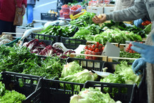Vegetable Street Market. Vendors Sell Green Salads And Various Vegetables