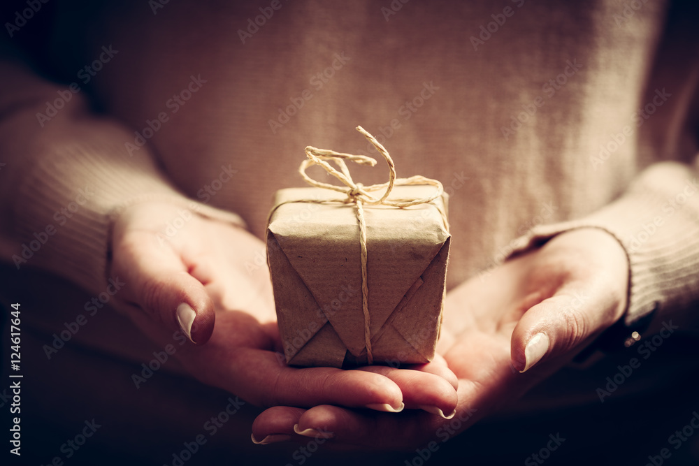 Fototapeta Giving a gift, handmade present wrapped in paper