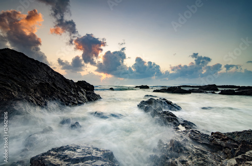 beautiful waves splashing on unique rocks formation at Pandak Be Poster