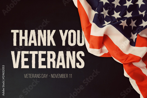 Fotografie, Obraz  Veterans day background with text and USA flag