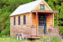 View Of Tiny House With Porch