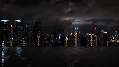 Night illuminated Kuala Lumpur, Malaysia Fototapet