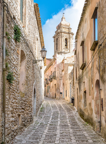 Vászonkép The narrow street of Erice with the church tower in background, Sicily, Italy