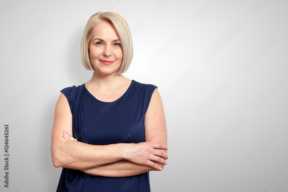 Fototapety, obrazy: Attractive middle aged woman with folded arms