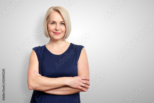 Foto  Attractive middle aged woman with folded arms