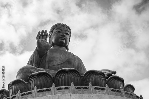 Tian Tan Buddha (Big Buddha) statue in black&white at Ngong Ping on Lantau Island in Hong Kong, China, viewed from below Wallpaper Mural