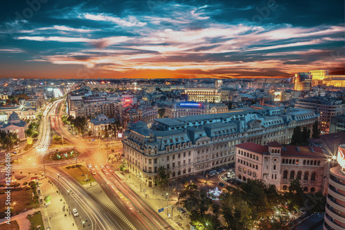 Aerial view of capital city Bucharest, Romania. University Square at sunset with traffic lights.