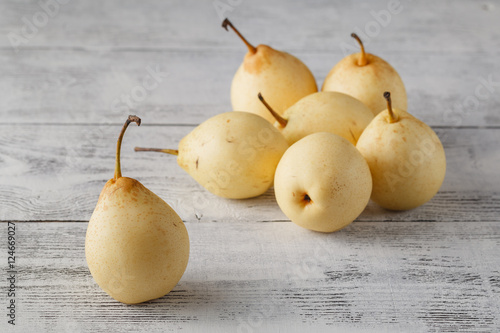 Delicious Williams or Bartlett pears on a rustic wooden kitchen Wallpaper Mural