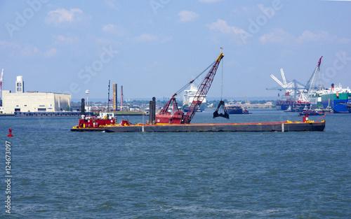 Fotografia, Obraz  Tugboat pushing dredging barge