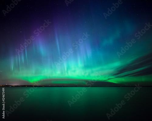 Foto auf Gartenposter Nordlicht Northern lights over lake in finland