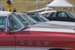 Close-up of an old car. Part of the exterior. An American classic. Chrome lining. Glass with reflection.