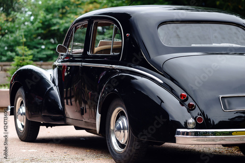 Fotografia  Beautiful retro car. Elegance and style of  first part of XX cen