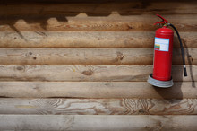 The Texture Of Weathered Wooden Wall With Extinguisher