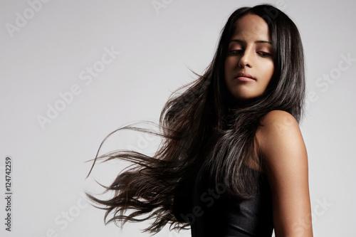 Fotografie, Obraz  woman with healthy brunette hair in studio shoot