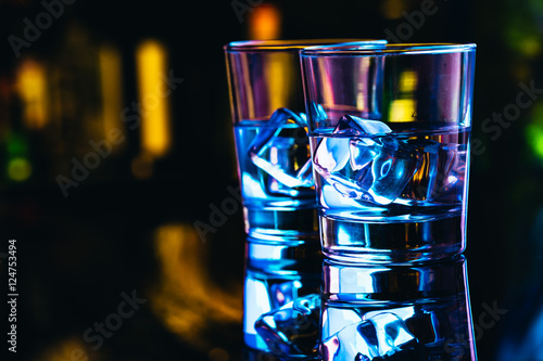 Two glasses of vodka with ice closeup Fototapeta