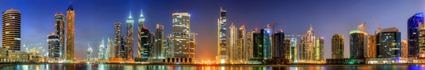 Fototapeta Panoramic view of Business bay and downtown area of Dubai at sunrise, UAE