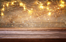 Empty Table In Front Of Christmas Warm Gold Garland Lights
