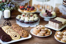 Table With Various Cookies, Tarts, Cakes, Cupcakes And Cakepops
