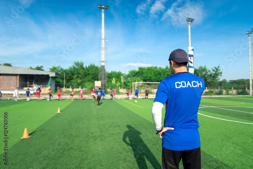 Fotografija  blurred image of Coach is coaching Children Training In Soccer T