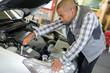 mechanic doing vehicle check-up