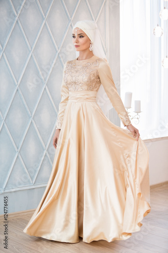 Portrait Of A Beautiful Muslim Bride In Gold Wedding Dress With White Headdress