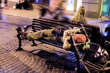 A Homeless Man Sleeping On A B...