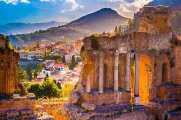 Fototapeta Architektura The Ruins of Taormina Theater at Sunset. Beautiful travel photo, colorful image of Sicily.