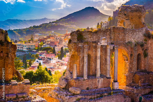 Photo sur Toile Brun profond The Ruins of Taormina Theater at Sunset. Beautiful travel photo, colorful image of Sicily.
