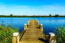 A Mooring Dock For Boats In The Bird Sanctuary Of Veluwemeer With Reed Along The Shore Under Blue Sky Near The Town Of Nijkerk In The Netherlands