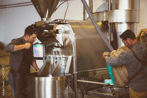Fotografija Two men working at coffee roasting factory