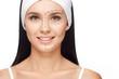 Leinwandbild Motiv Woman with perforation lines on her face