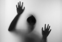 Horror Woman Behind The Matte Glass In Black And White. Blurry H