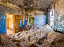 Room Full Of Sand With Colored Door In The Ghost Town Of Kolmanskop, Namibia