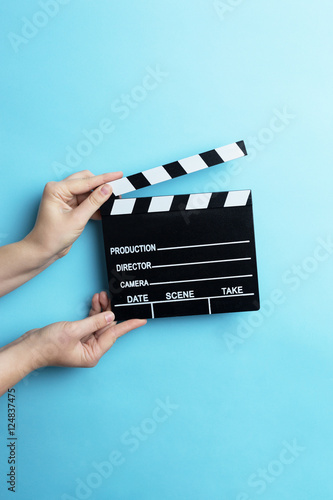 movie clapper on blue background, cinema concept