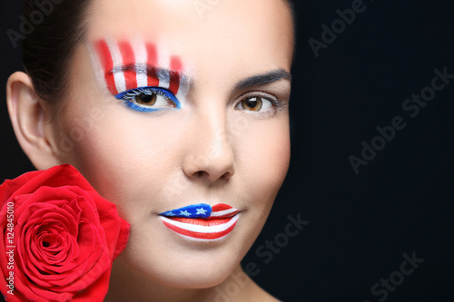 Garden Poster Beauty Girl with USA makeup and red rose on black background