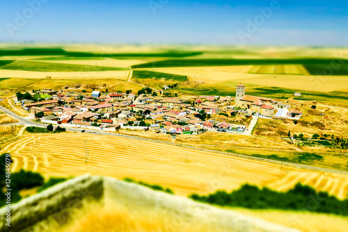 An aerial view of a spanish town at the countryside, at Palencia, Spain. Tilt-shift effect applied (model-like view).
