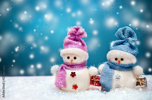 Snowmen couple with blue winter background