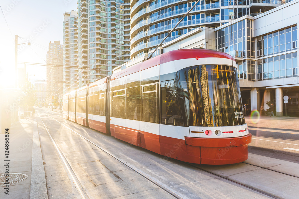 Fototapety, obrazy: Modern tram in Toronto downtown at sunset