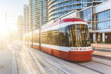 Modern Tram In Toronto Downtown At Sunset