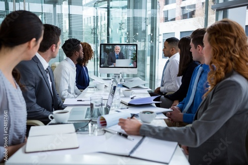 Fototapety, obrazy: Business people looking at a screen during a video conference