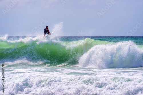 Poster Water Motor sports Surfer riding a huge wave in Lacanau, France