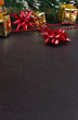 Christmas or New Year dark wooden background, Xmas black board framed with season decorations