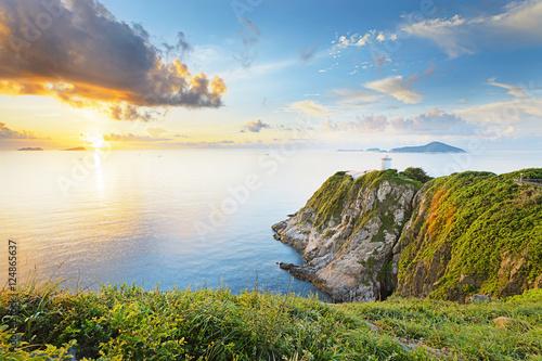 Hong Kong lighthouse during sunrise плакат