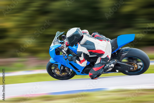 Photo Stands Motor sports Motorcycle leaning into a fast corner on highway