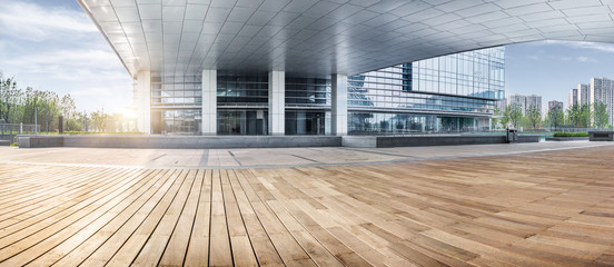 Fototapeta office building entrance with wooden floor foreground,china.