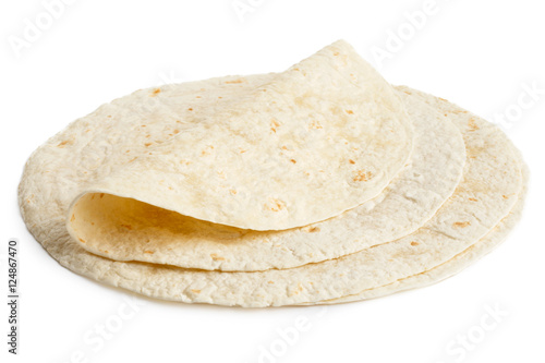 Fotografie, Obraz  Stack of tortilla wraps and one folded wrap isolated on white.