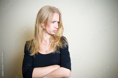 Valokuva  Young blonde woman angry and sullen portrait