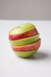 Stack of green and red apple