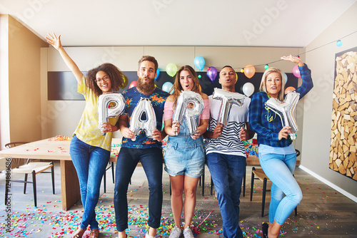 Fotografie, Obraz  Happy group holding PARTY letters