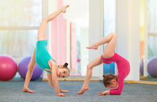 Flexible Kids Gymnasts Doing A...